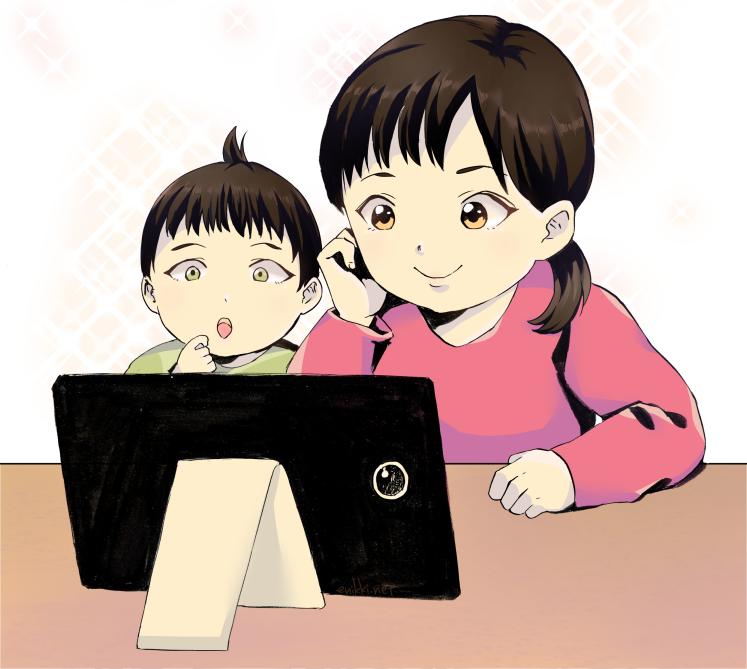 スマホやタブレットを見る子供